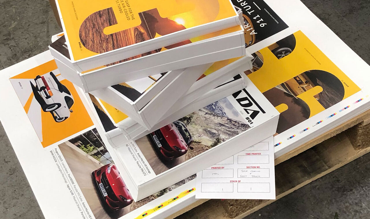 A large stack of printed Strada Magazines